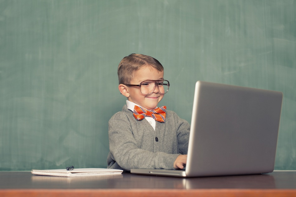 Kid on computer with glasses