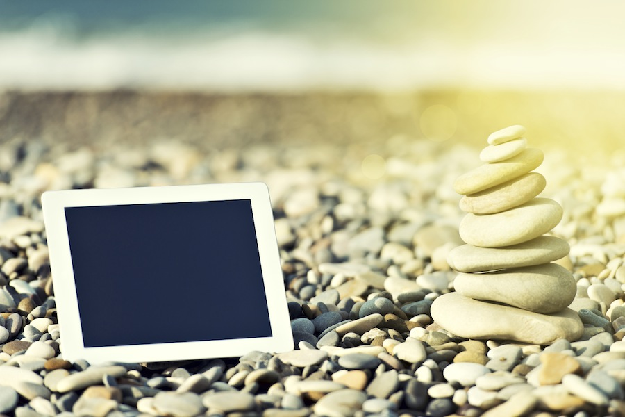 Tablet on Beach with Rocks